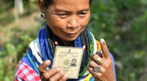 A Reyang lady is showing her marked finger after casting her vote in a polling station during Tripura legislative assembly elections in Agartala, the capital of northeastern state of Tripura on February 18. (Express Photo: Abhisek Saha)
