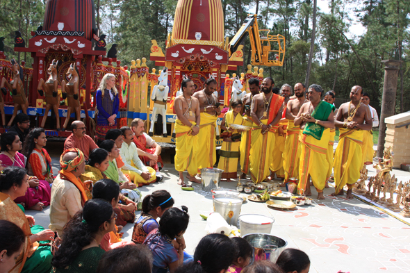 Kumbhabhisheka ceremony (Priests getting ready to give bath to the deities outside the temple)