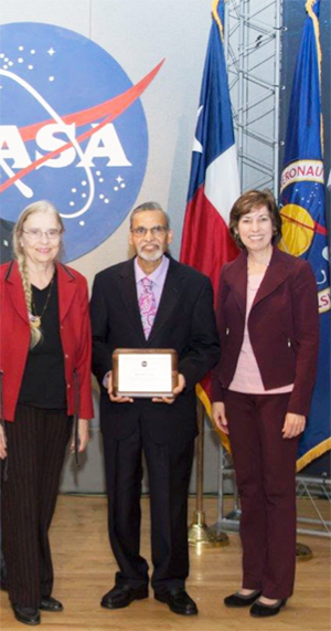 Dr Lulla with his wife Marianne Lulla and Center Director Dr. Ellen Ochoa.