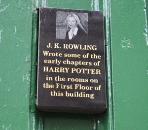 A plaque outside the Black Medicine Coffee Co. heralds how J.K. Rowling of Harry Potter fame wrote in its rooms.