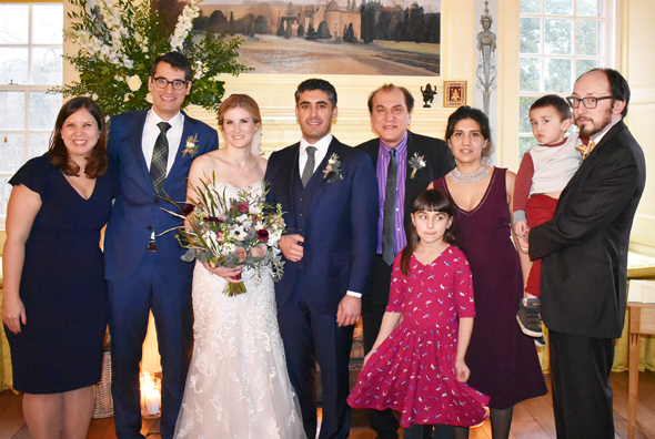 The groom's father Jawahar Malhotra (right) and Stefan's brother Jeremy and his wife Kathryn with the newlyweds (on left) and his cousin Meena Murphy, husband Dan and kids Shashi Nila and Shiva.