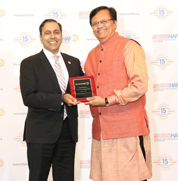 Congressman Raja Krishnamoorthi presents HAF's Pride of the Community award to Sewa International Houston Chapter President Gitesh Desai.