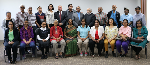 The seminar organizers (backrow center), from left Anasuya Kabad, Jay Kabad, Biki Mohindra and Pramod Kulkarni with the seniors who came to attend the first of a series of financial education seminars held at India House on Monday, April 16.