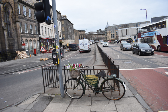 An eye catching bicycle parked in the traffic island