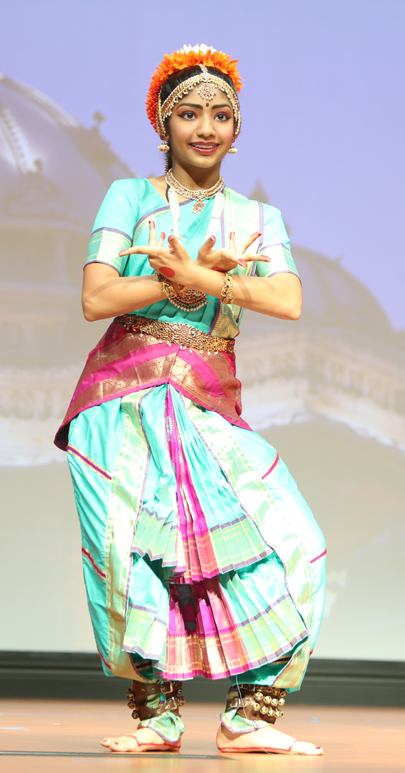 Aanshi Trivedi performs a traditional dance at the beginning of the conference.