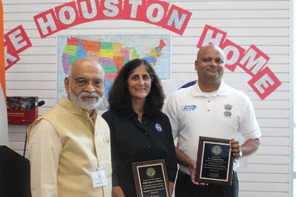 Key Note speaker NASA astronaut Sunita Williams and Chief Guest, Consul General, Dr. Anupam Rayreceivedawards from FIS Chair, Krishna Vavilala.