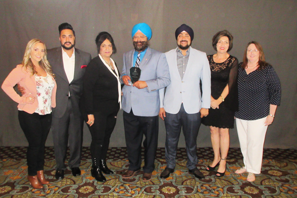Harjit Galhotra, President and founder of Galson Auto & Body proudly holds the Winners of Distinction Award presented at the BBB Awards ceremony held on Wednesday, May 9 at the Bayou City Event Center. With him, from left are Kayla Fisher, son Balraj, wife Seema, son Ravi, Denise Roca and Tobi Gourley.