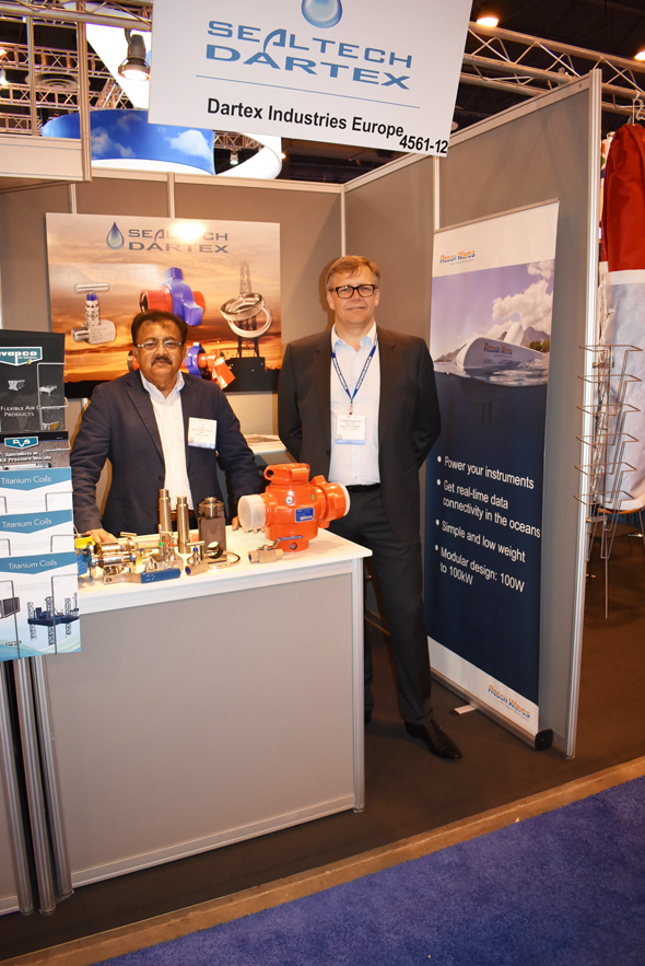 T.J. Sinha, a longtime exhibitor at the Offshore Technology Conference at his company Dartex's booth with Torben Marius Gregersen (right), Business Development Director of Makeen Power.