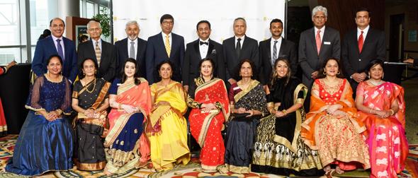 Pratham Houston Board members and their spouses at the Pratham Houston Gala 2018 held on Saturday, May 12 at Hilton Americas in Downtown Houston. Standing: Dr. Randeep Suneja (left), Anil Shah, Brij Kathuria, Sagar Naik, Pankaj Dhume, Somesh Singh, Mehul Parikh, Dhamo Dhamotharan, and Shawn Karande. Sitting: Seema Suneja (left), Purnima Shah, Shital Patel,Annu Naik, Asha Dhume, Jyothi Singh, Dr. Sapna Singh, Seema Karande,and Rema Dhamodharan.