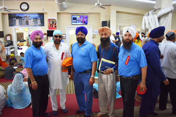 Busy throughout the day were, from left, Bhupinder Singh, Harjit Galhotra, Gurminder Anjala and Gurmeet Singh