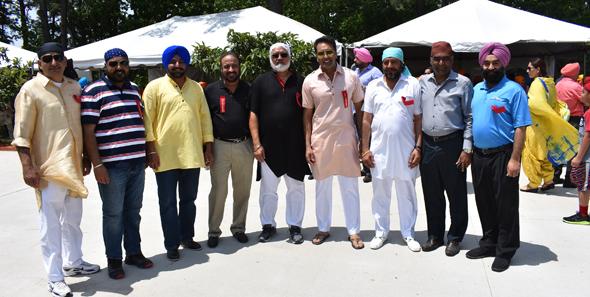 Mela organizers and volunteers, from left, Harwinder Singh, Ripudaman Boparai, Gurbir Boparai, Manohar Singh Mann, Hitpaul Singh Sandhar, Bhupinder Singh, Batcha Tiwari (a vendor) and Gurmeet Saini.
