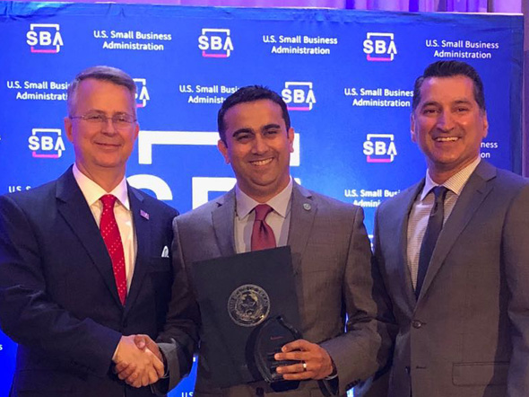 Aziz Rahim, Sr. Vice President at Wallis State Bank receives the SCORE/SBA's Financial Services Champion of the Year award from Tim Jeffcoat, Houston SBA District Director (left) and Asif Dakri, CEO, Wallis State Bank (right).