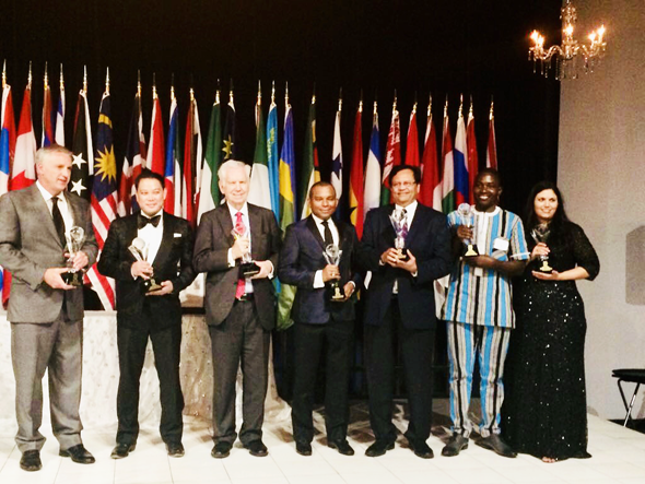 """G7 Awardees for the year: Gitesh Desai, Sewa International's Houston Chapter President, pictured third from right, with the award for """"Outstanding Nonprofit"""", at the Bayou Place, Houston."""