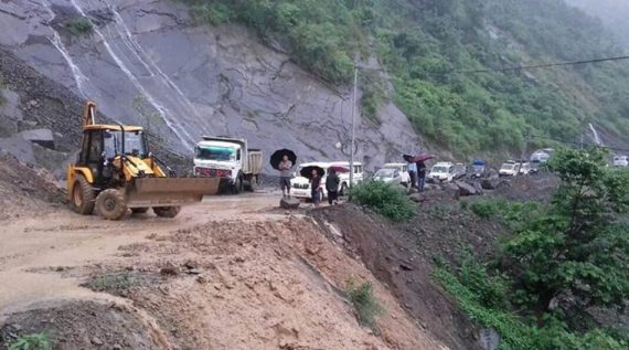 About 50 metres stretch of the National Highway has been blocked by debris brought down by the landslide near Sinam village, 35 km from Imphal.