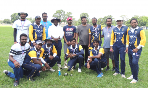 Runners up CFCC with umpires of the game, Tony and Kushal.