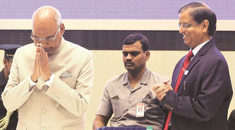 President Ram Nath Kovind (left) and Economic Affairs Secretary Subhash Chandra Garg at the platinum jubilee celebrations of the Institute of Cost Accountants of India in New Delhi on Saturday. (Express Photo by Amit Mehra)
