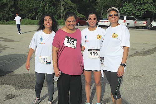 At the 5K Run/Walk for a Cancer Cure were from right, Kanchan Kabad from IACAN, Pooja Prasad and her mother Mangala Prasad, President of HKV and a participant.