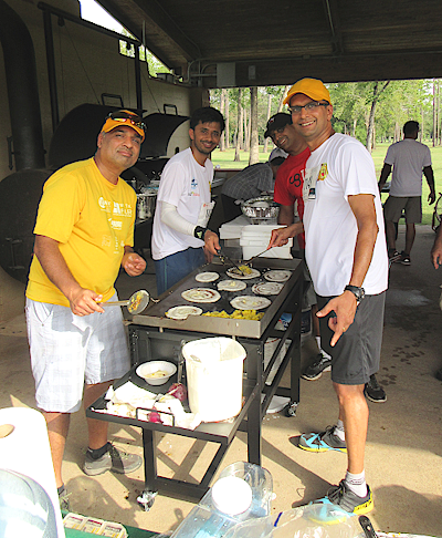 One of the dosa making teams working feverishly to perfect their art before a competition with the other team.