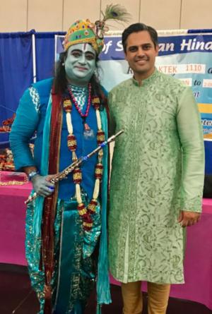 Congressional Dist. 22 Democratic challenger Sri Preston Kulkarni at the recent Janamashtami celebration at the GRB Center with Sri Ravula dressed as Krishna.