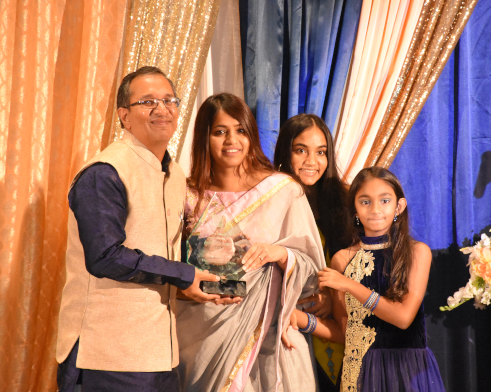 Achalesh Amar the recipient of the Seva Sadhak Award, with his wife Smita and daughtersAnanya and Aagrima.