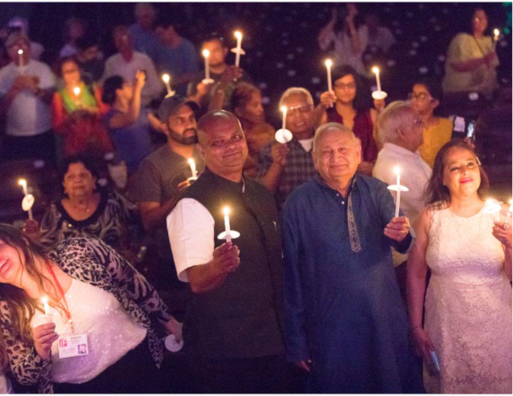 Consul General of India, Dr. Anupam Ray along with Devinder Mahajan of Arya Samaj Greater Houston participating in candle lighting. Photo: Kumaresh Tahkku.
