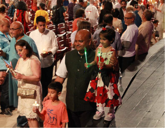 Dr. Anupam Ray encouraging and posing with the children at the 1000 Lights for Peace. Photo: Rajan Chawla