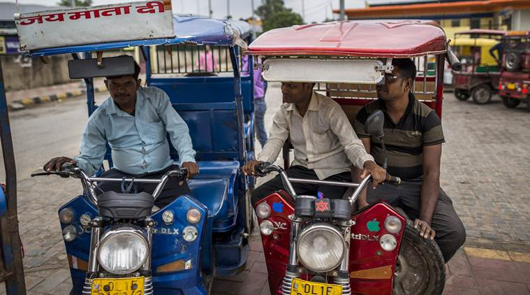 E-rickshaw drivers wait for passengers at a rickshaw stand in New Delhi, India. (Source: Prashanth Vishwanathan/Bloomberg)