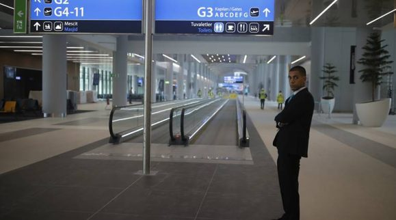 A security guard stands inside a terminal at Istanbul's new airport, ahead of its opening. (AP Photo/Emrah Gurel, File)