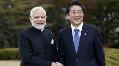 India's Prime Minister Narendra Modi, left, shakes hands with Japan's Prime Minister Shinzo Abe in Yamanakako village, Yamanashi prefecture, Sunday. (Suo Takekuma/Kyodo News via AP)