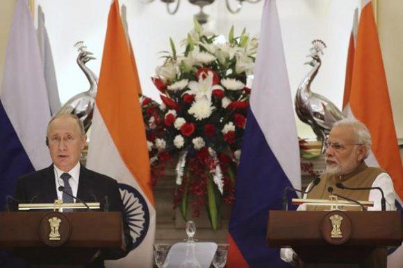 Russian President Vladimir Putin with Prime Minister Narendra Modi in New Delhi on Friday. Photo: PTI