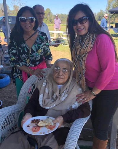 From left, Paru McGuire, Club 65 President; Shakuntala Malhotra Club 65's oldest and first Life Member and Rozina Jafferali at the picnic table
