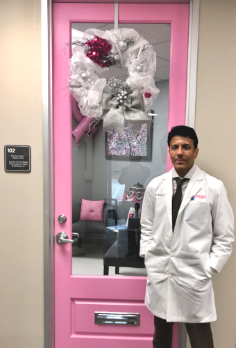 Dr. Mahesh Shetty in front of the Pink Door Imaging clinic, located at 2424 W. Holcombe Blvd., Tel (832) 804-8119, Fax (832) 804-8120. www.womans-clinic.com