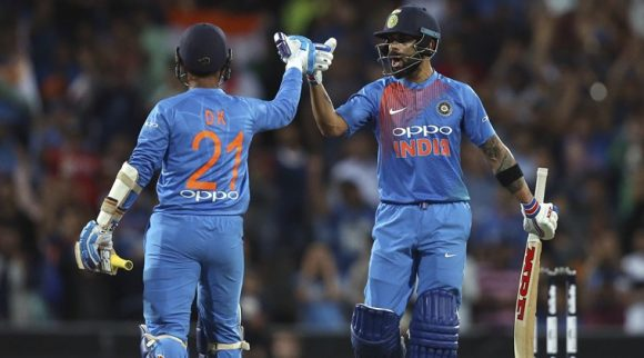 Virat Kohli celebrates with Dinesh Karthik after hitting the winning runs in the third and final T20 in Sydney. (Source: AP)